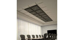 dark-grey-lighted-tiles-focus-above-conference-table-in-office-hero-1280x700